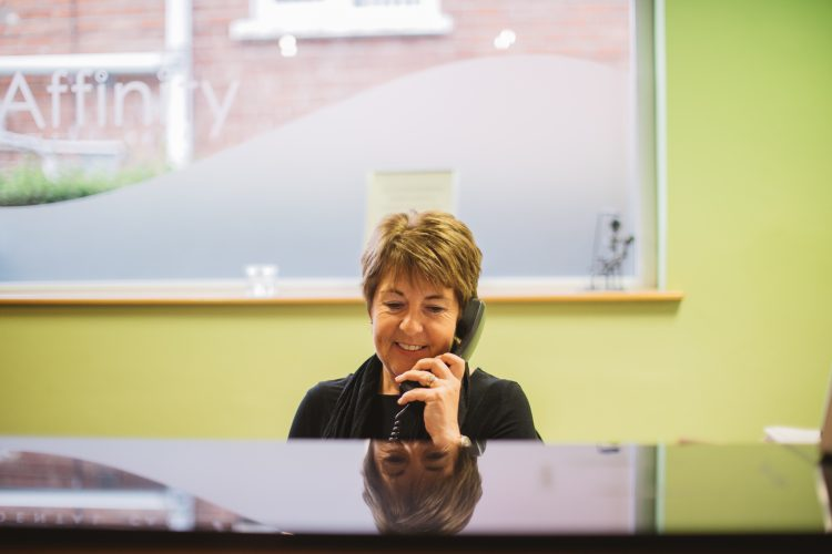 Affinity Dental Care receptionist answering phone